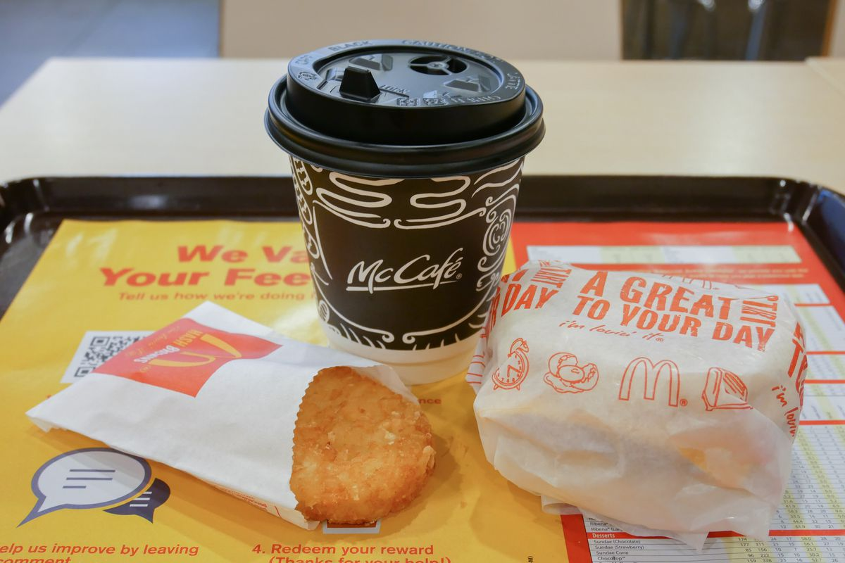 McDonald's breakfast, with coffee, hash brown, and McMuffin.