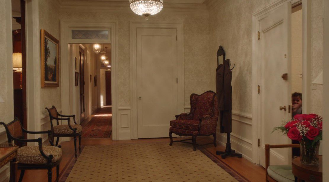 A foyer with a view down the bedroom hallway.