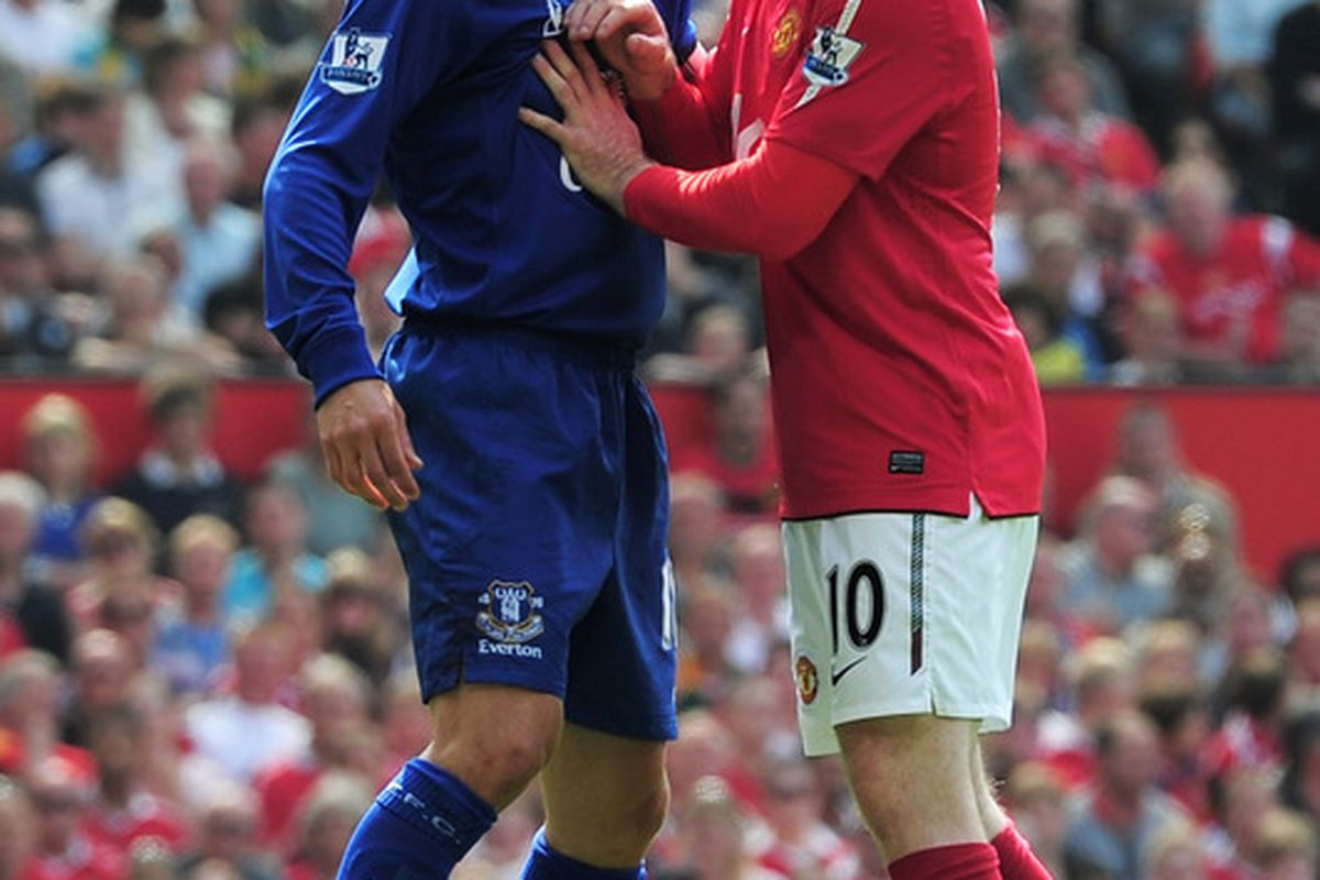 Old Boys Club - Former United player Phil Neville of Everton exchanges a joke with former Everton player Wayne Rooney of Manchester United.  (Photo by Shaun Botterill/Getty Images)