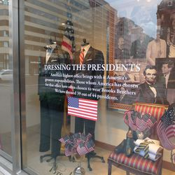 Brooks Brothers' Connecticut Avenue shop window celebrates dressing 39 out of 44 presidents.