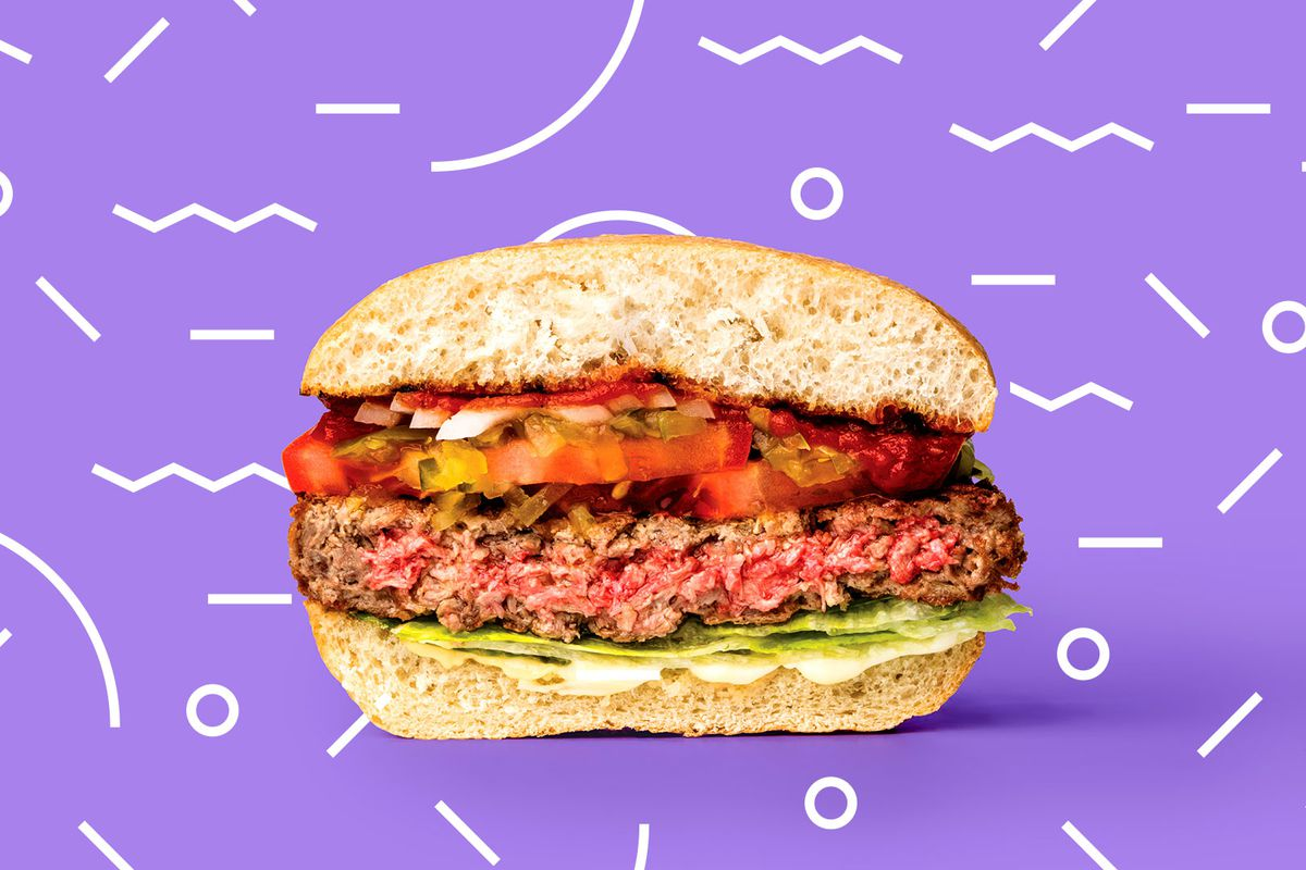 A cross section of an Impossible Burger against a jazzy purple background.