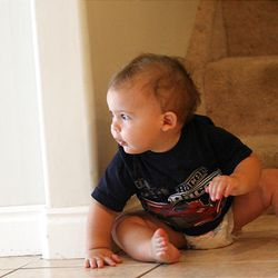 Caedan Crabill, 11 months old, plays in his Salt Lake home Aug. 4. His mother buys disposable diapers for him.