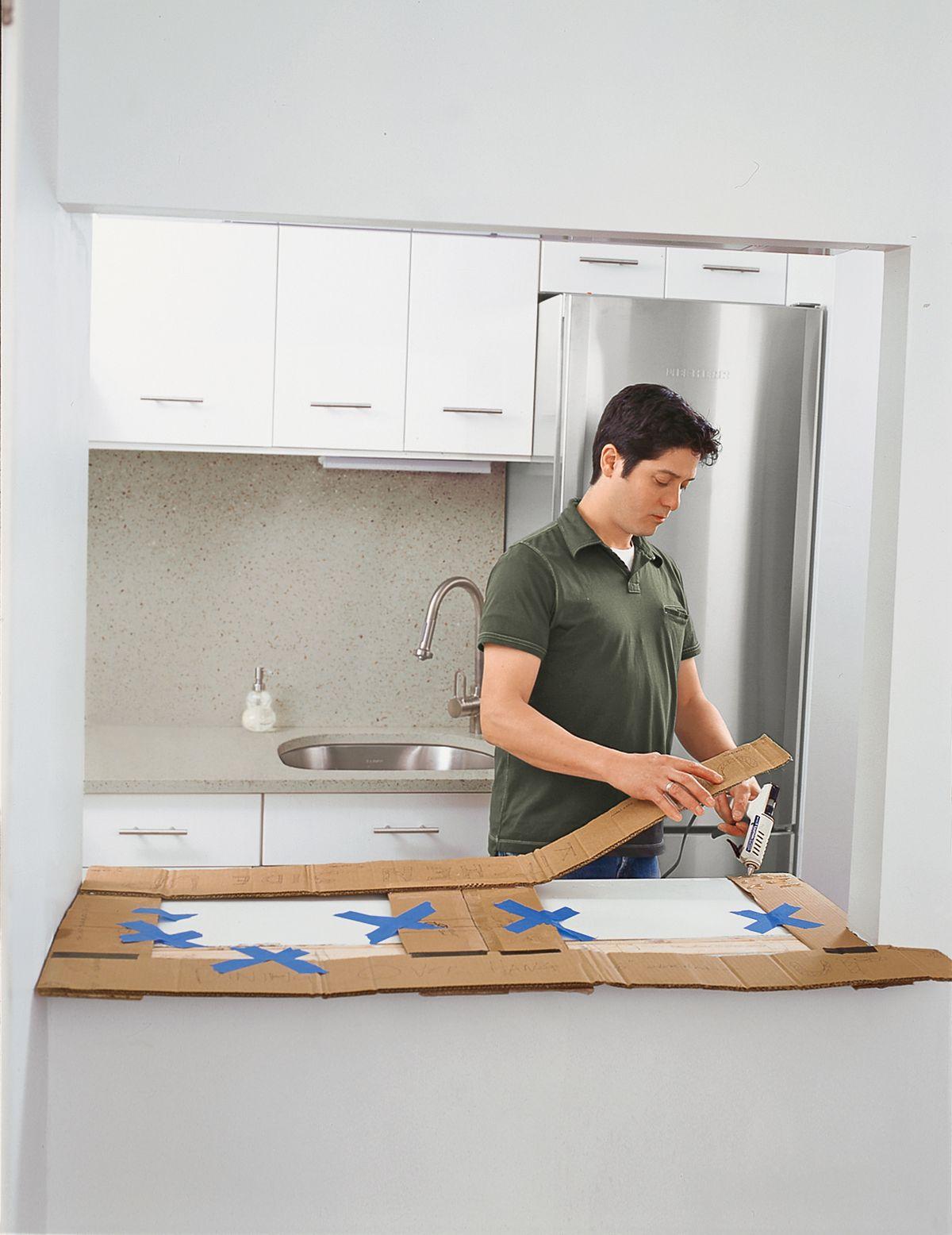 Man Assembles Cardboard Template Of Butcher Block