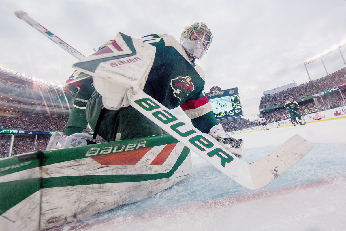 Devan Dubnyk #40 of the Minnesota Wild defends his goal against the Chicago Blackhawks during the 2016 Coors Light NHL Stadium Series on February 21, 2016 at TCF Bank Stadium in Minneapolis, Minnesota.