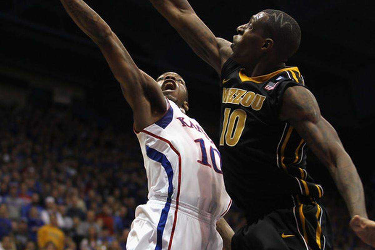 LAWRENCE KS - FEBRUARY 07:  Tyshawn Taylor #10 of the Kansas Jayhawks shoots as Ricardo Ratliffe #10 of the Missouri Tigers defends during the game on February 5 2011 at Allen Fieldhouse in Lawrence Kansas.  (Photo by Jamie Squire/Getty Images)