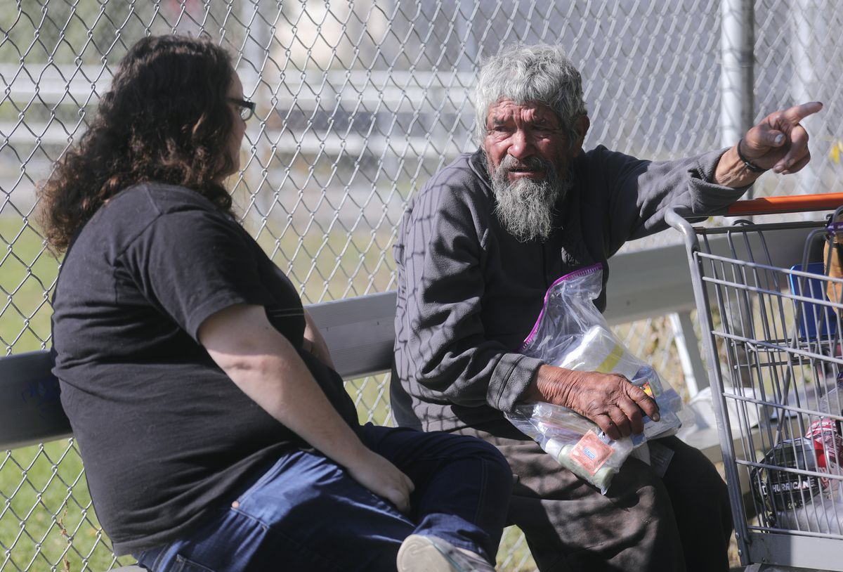 Courtney Slater, street outreach specialist with Weber Housing Authority, talks with Miguel Gomez, who is homeless, in Ogden on Tuesday, Oct. 1, 2019.