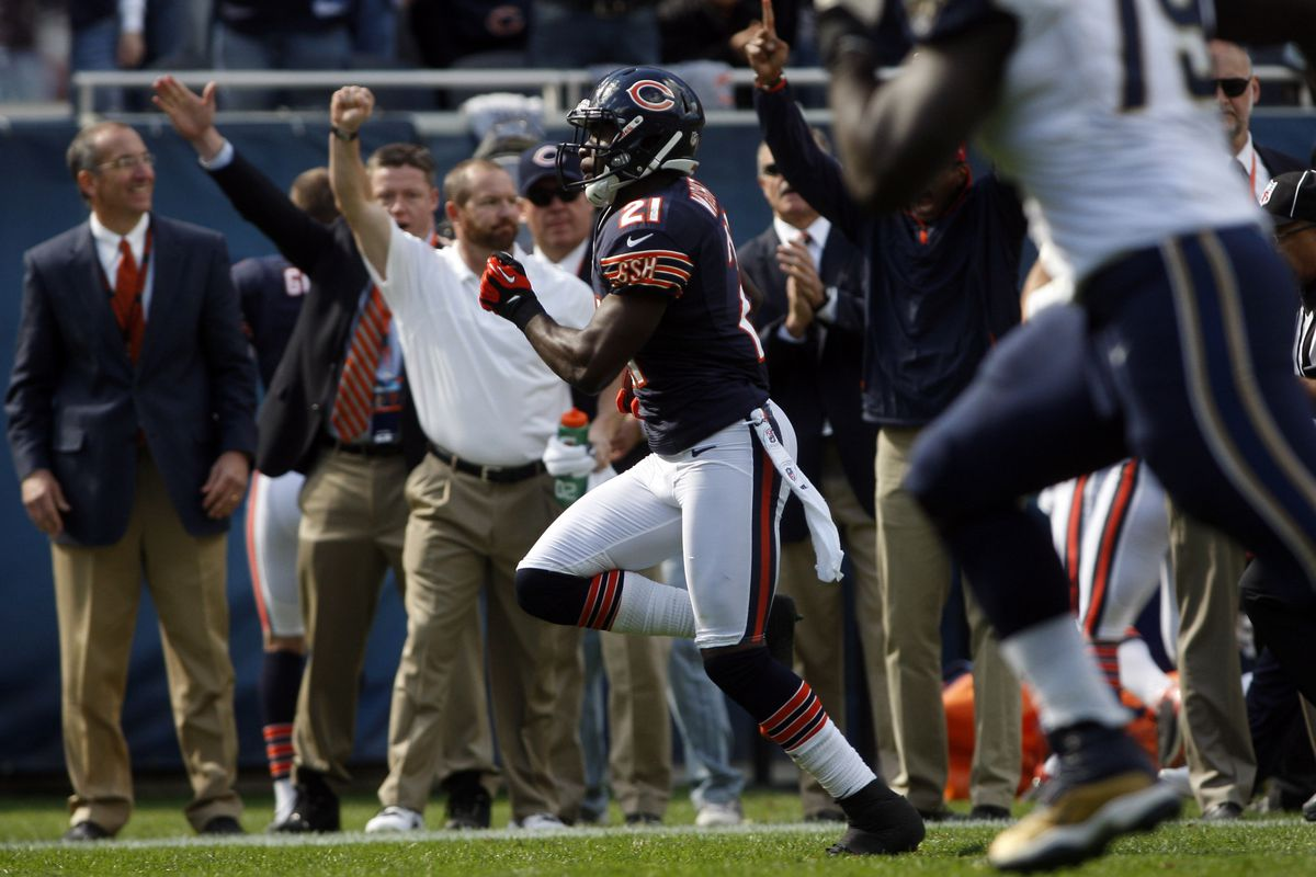 Sep 23, 2012; Chicago, IL, USA; Chicago Bears strong safety Major Wright (21) returns an interception for a touchdown during the fourth quarter against the St. Louis Rams at Soldier Field.  The Bears won 23-6. Mandatory Credit: Jerry Lai-US PRESSWIRE