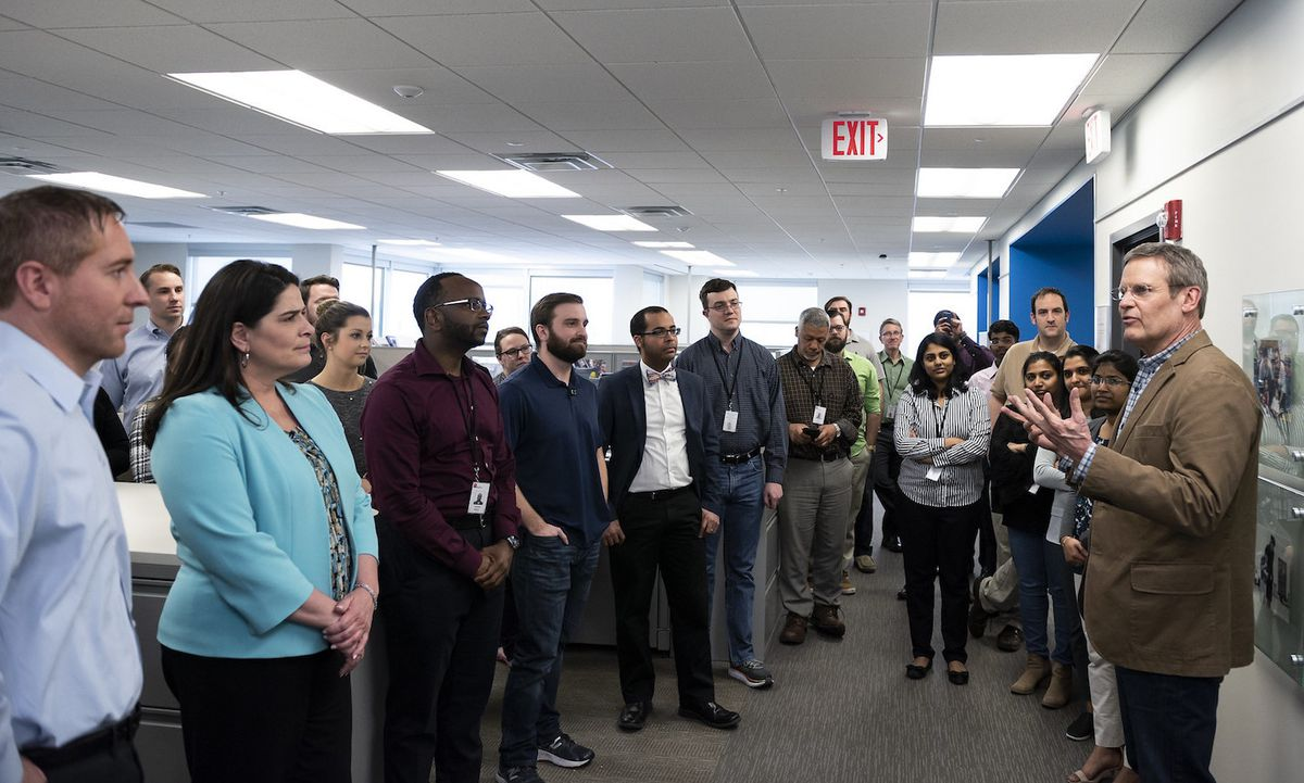 New Gov. Bill Lee (right) visits with staff at the Tennessee Department of Education during a tour of its Nashville offices early in his administration.