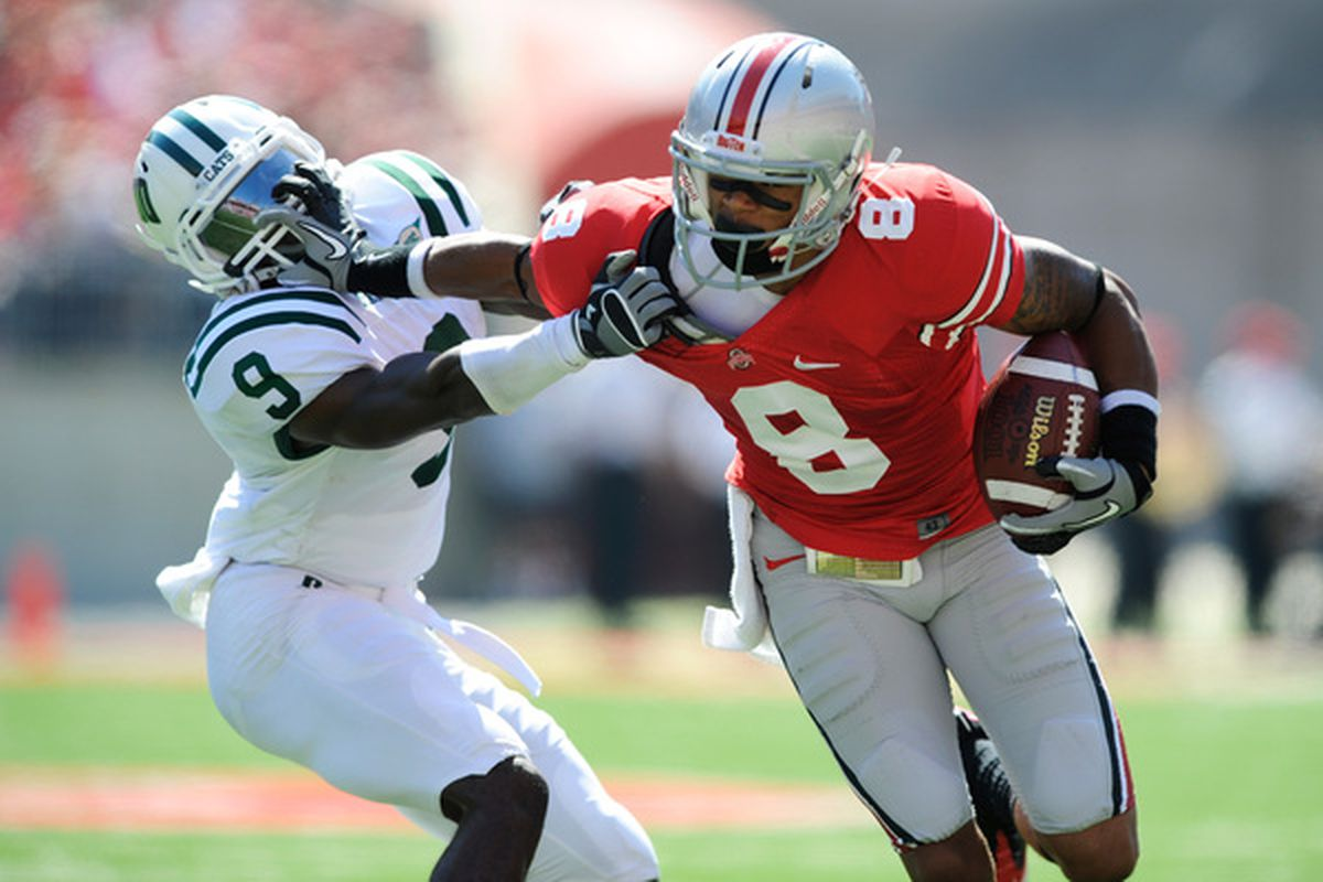 COLUMBUS OH - SEPTEMBER 18:  DeVier Posey #8 of the Ohio State Buckeyes stiff arms his brother Julian Posey #9 of the Ohio Bobcats at Ohio Stadium on September 18 2010 in Columbus Ohio.  (Photo by Jamie Sabau/Getty Images)
