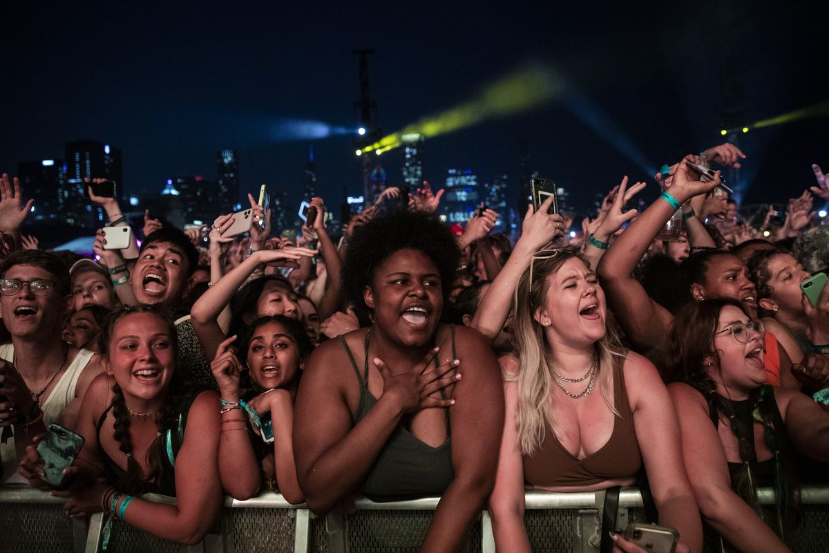 Fans cheer as Post Malone performs on day three of Lollapalooza in Grant Park, Saturday evening, July 31, 2021.