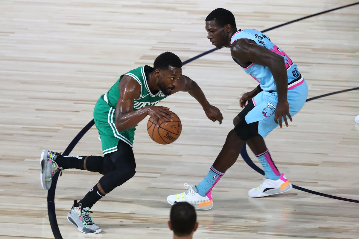 Boston Celtics guard Kemba Walker drives against Miami Heat guard Kendrick Nunn in the first half of a NBA basketball game at the Visa Athletic Center in the ESPN Wide World of Sports Complex.