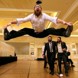 Nochum Greenwald dances during Chaya Zippel and Rabbi Mendy Cohen's traditional Hasidic wedding at the Grand America Hotel in Salt Lake City on Monday, Sept. 12, 2016.