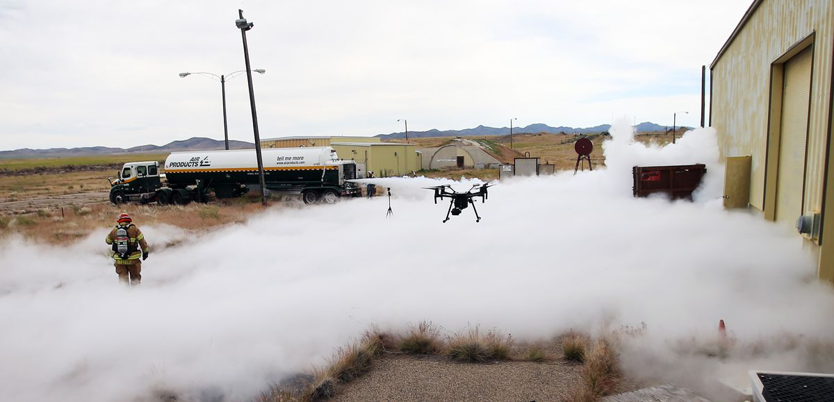 A firefighter walks around in the nitrogen as a drone flies near by as Deseret UAS group hosts a two day workshop on deploying drones in hazardous materials situations for emergency responders at the Tekoi Test Range on the Goshute Skull Valley Reservation on Tuesday, June 25, 2019.