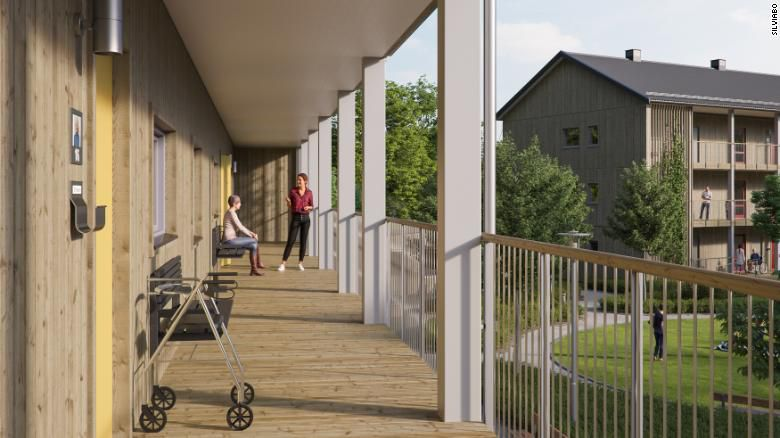 Rendering of elderly people on a terrace outside apartments.