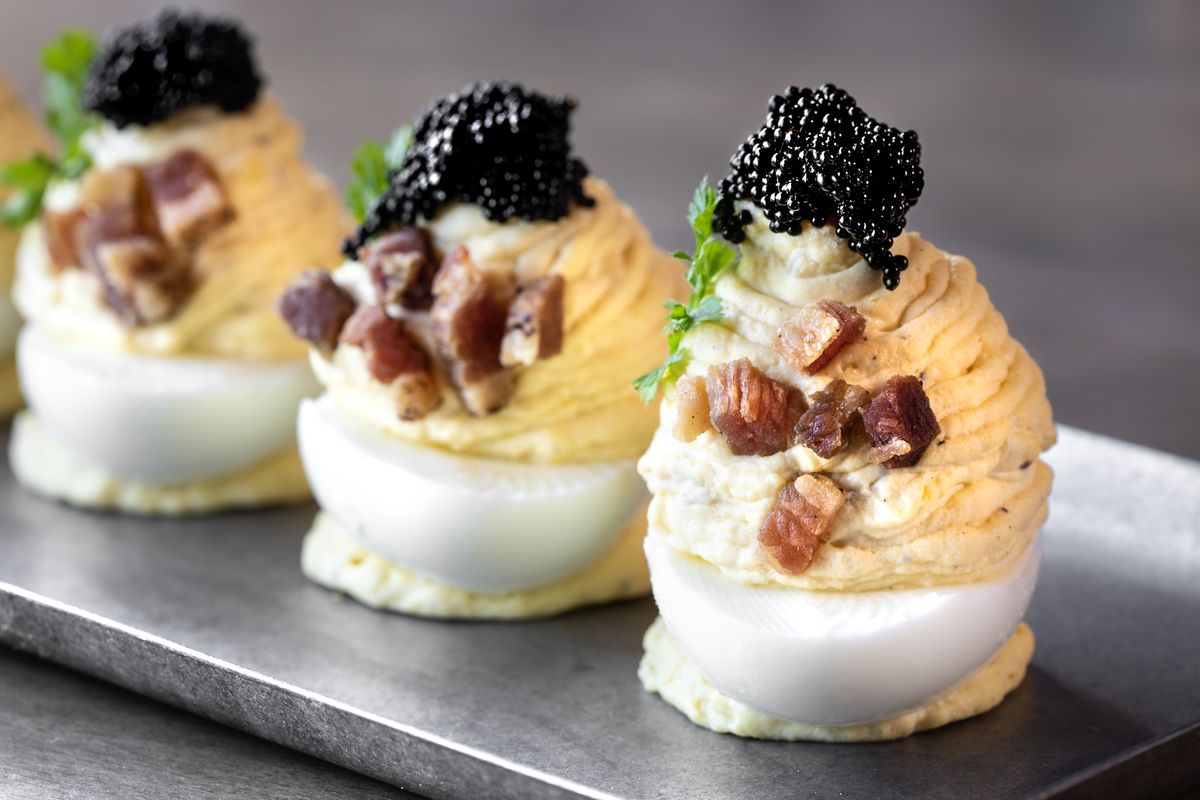 Deviled eggs with bacon and topped with caviar from Carson Kitchen