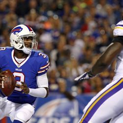 Aug 16, 2013; Orchard Park, NY, USA; Buffalo Bills quarterback E.J. Manuel (3) drops to pass as Minnesota Vikings defensive end George Johnson (92) rushes during the second half at Ralph Wilson Stadium. Bills beat the Vikings 20-16.