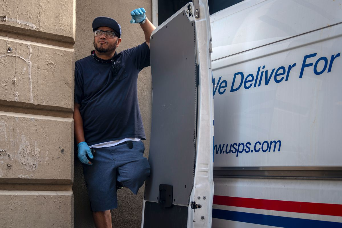 USPS courier Frankie Rodríguez, 52, works at the Industry City branch in Brooklyn, Aug. 21, 2020.