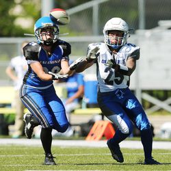 Utah Falconz cornerback Nicole Olson intercepts the ball and scores against the Colorado Freeze in Murray on June 13, 2015. The Falconz compete in a women's tackle football league.