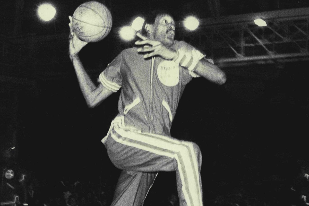 """Harlem Globetrotter James """"Twiggy"""" Sanders in section at the Hordern Pavillion this evening, Wednesday.""""Twiggy"""" sanders in action at the Hordern Pavilion.'Twiggy' Fills A Tall Order — The Goose... Meadowlark... Geese... and now James """"Twiggy"""" Sanders.""""Tw"""