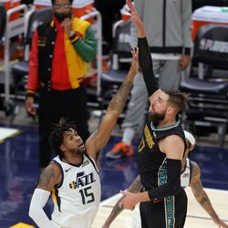 Memphis Grizzlies center Jonas Valanciunas (17) pushes up a shot over Utah Jazz center Derrick Favors (15) as the Utah Jazz and the Memphis Grizzlies play in game one of their NBA playoff series at Vivint Arena in Salt Lake City on Sunday, May 23, 2021.