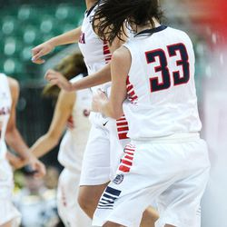 Gonzaga Bulldogs guard Keani Albanez (24) celebrates her final basket in the first half during the West Coast Conference championship game in Las Vegas Tuesday, March 11, 2014. BYU lost 71-57.
