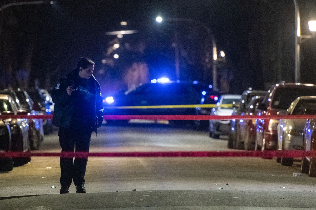 Chicago Police investigate the scene where a man was shot in a drive-by Saturday night in the 600 block of North Ridgeway, in the East Garfield Park neighborhood.   Tyler LaRiviere/Sun-Times
