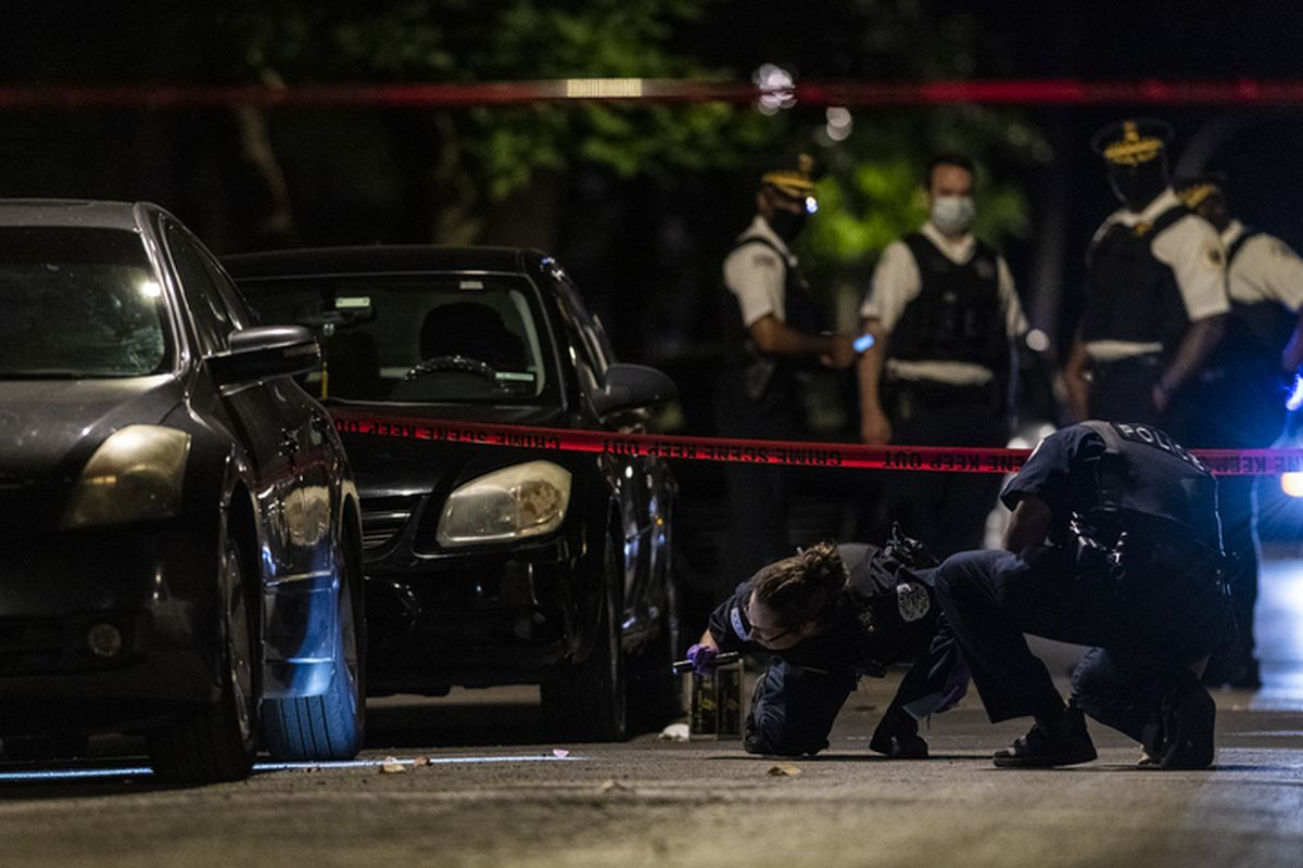 Chicago police investigate the scene where four people were shot, including an 8-year-old boy, Aug. 5, 2020, in the 700 block of South Karlov Avenue.