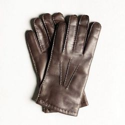 """Leather gloves linked with Scottish pine green cashmere, <a href=""""http://shop.freemanssportingclub.com/collections/accessories/products/leather-gloves"""">$196</a> at Freeman's Sporting Club; keep those digits warm when you're not there to do the job"""