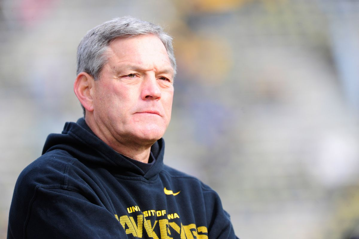 Kirk Ferentz loves Christmas. You can tell by the look on his face.