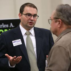 Charles Stormont, Democratic candidate for Utah attorney general, talks to Bill Egelund at the Utah Education Association Convention and Education Exposition at the South Towne Expo Center in Sandy on Thursday, Oct. 16, 2014.