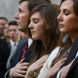 Stan Lockhart, husband of former Speaker of the House Rebecca Lockhart, and daughters Hannah Lockhart and Emily Britton attend the memorial service for their wife and mother in the Capitol rotunda in Salt Lake City on Thursday, Jan. 22, 2015. Lockhart died at her home in Provo on Jan. 17, 2015, from a rare brain disease.