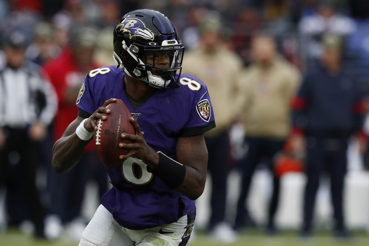 Quarterback Lamar Jackson of the Baltimore Ravens looks to throw the ball during the second half against the Houston Texans at M&T Bank Stadium on November 17, 2019 in Baltimore, Maryland.