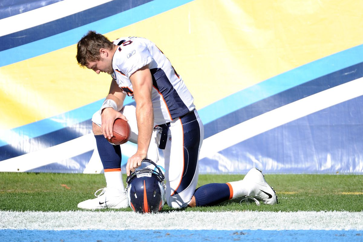 Tim Tebow #15 of the Denver Broncos prays before the game against the San Diego Chargers at Qualcomm Stadium on November 27, 2011 in San Diego, California.  The Broncos went on to win 16-13 in overtime.   (Photo by Harry How/Getty Images)
