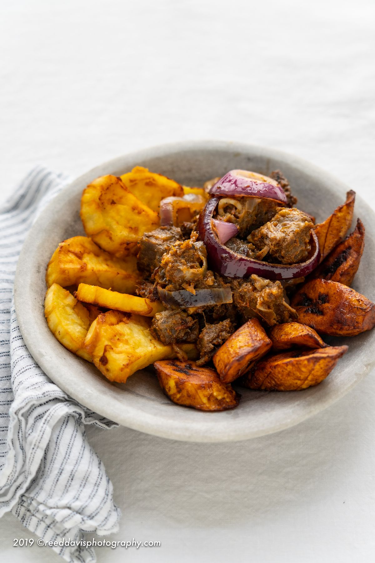 Asun with plantains and sweet potatoes from Eko Kitchen