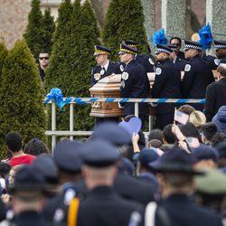 Pallbearers carry the casket of Chicago Police Officer John P. Rivera. | Ashlee Rezin/Sun-Times