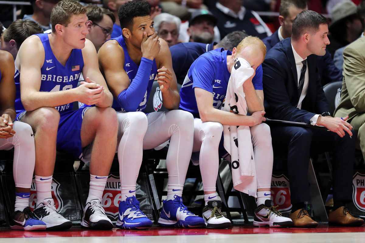 Brigham Young Cougars forward Kolby Lee (40), Brigham Young Cougars forward Yoeli Childs (23) and Brigham Young Cougars guard TJ Haws (30) sit on the bench as Utah and BYU play an NCAA basketball game at the Huntsman Center in Salt Lake City on Wednesday, Dec. 4, 2019. Utah won 102-95 in overtime.