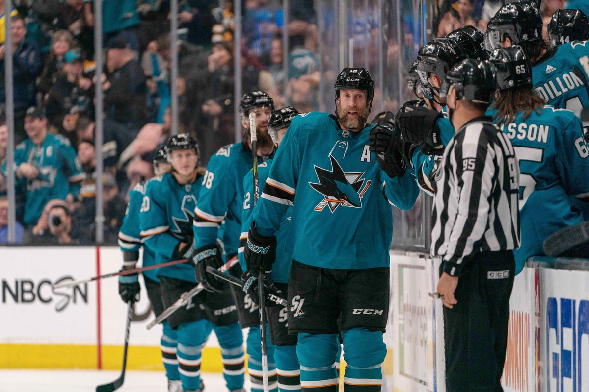 Feb 18, 2019; San Jose, CA, USA; San Jose Sharks center Joe Thornton (19) gets congratulated by the bench during the second period after scoring a goal against the Boston Bruins at SAP Center at San Jose.