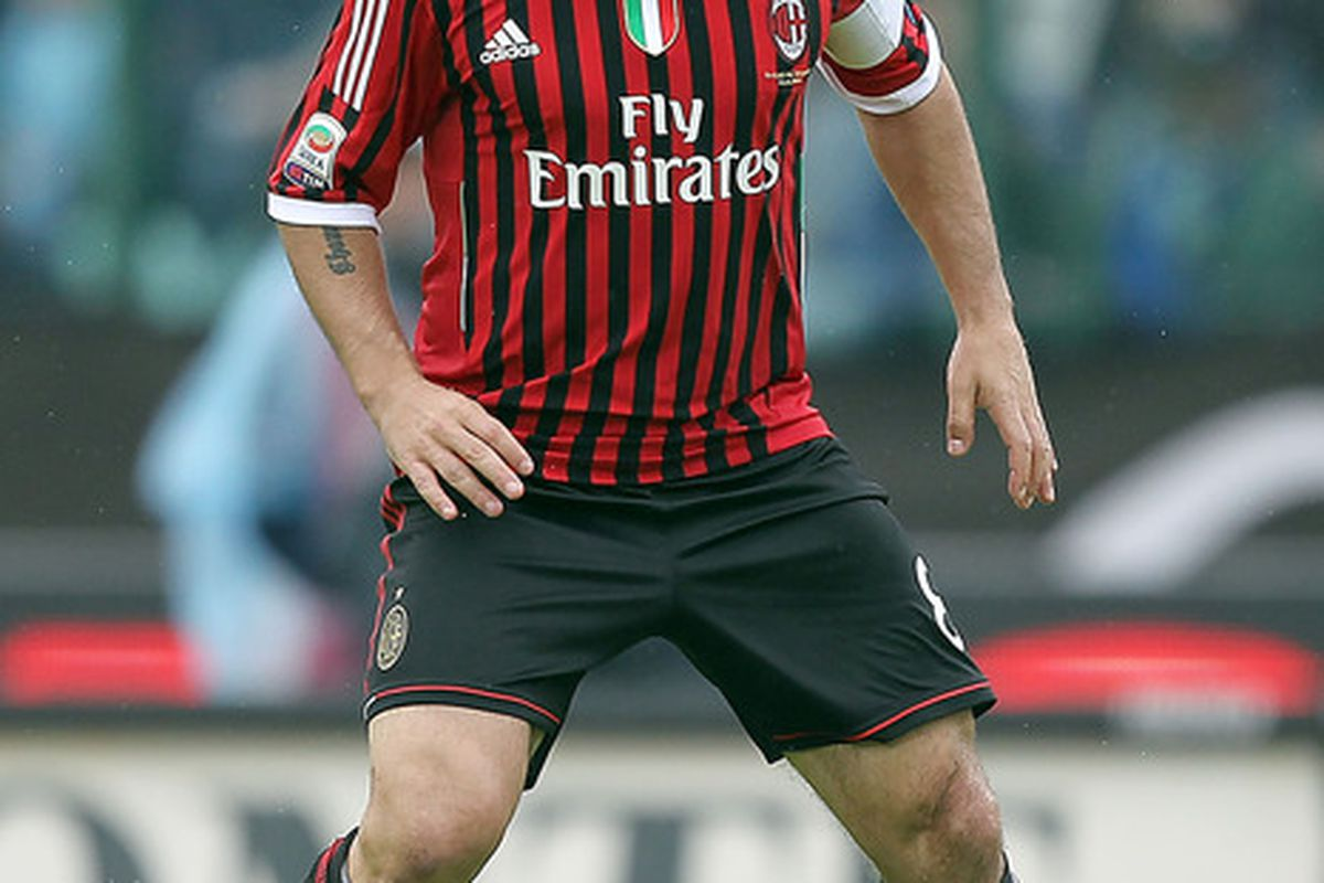 SIENA, ITALY - APRIL 29: Gennaro Gattuso of AC Milan in action during the Serie A match between AC Siena and AC Milan at Artemio Franchi - Mps Arena Stadium on April 29, 2012 in Siena, Italy.  (Photo by Gabriele Maltinti/Getty Images)
