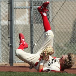 American Fork's Dax Newman dives and catches a foul ball against Skyridge in American Fork on Friday, April 30, 2021.