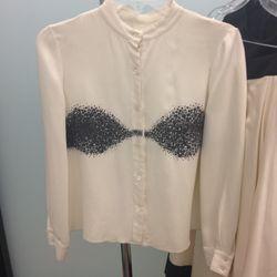 Cream high-neck blouse, $100