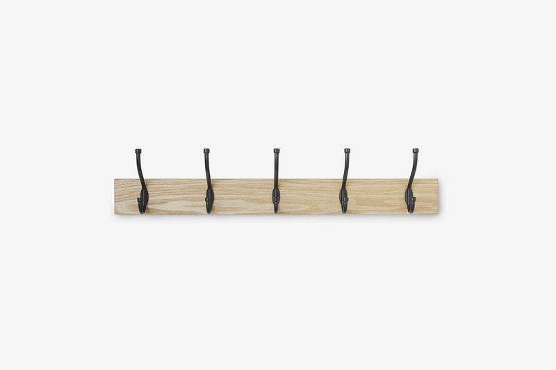 Horizontal wooden hanger with five black hooks.