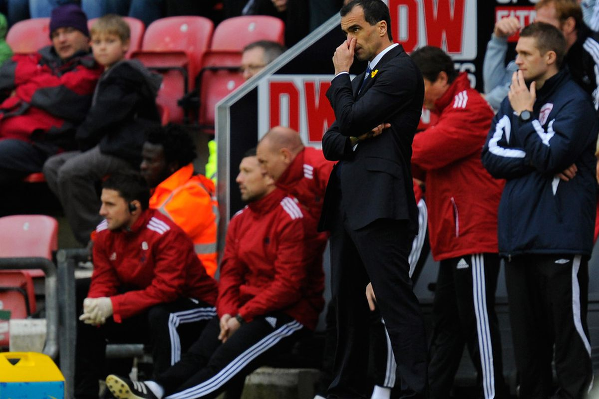Wigan manager Roberto Martinez looks on during the Barclays Premier League match between Wigan Athletic and Swansea City at DW Stadium.