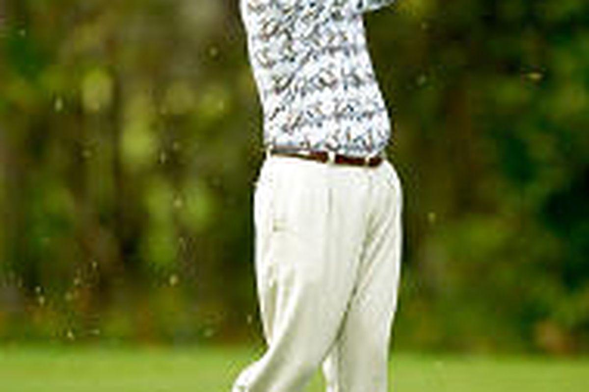 John L. Lewis follows through on his fairway shot on the ninth hole of Disney's Magnolia golf course.