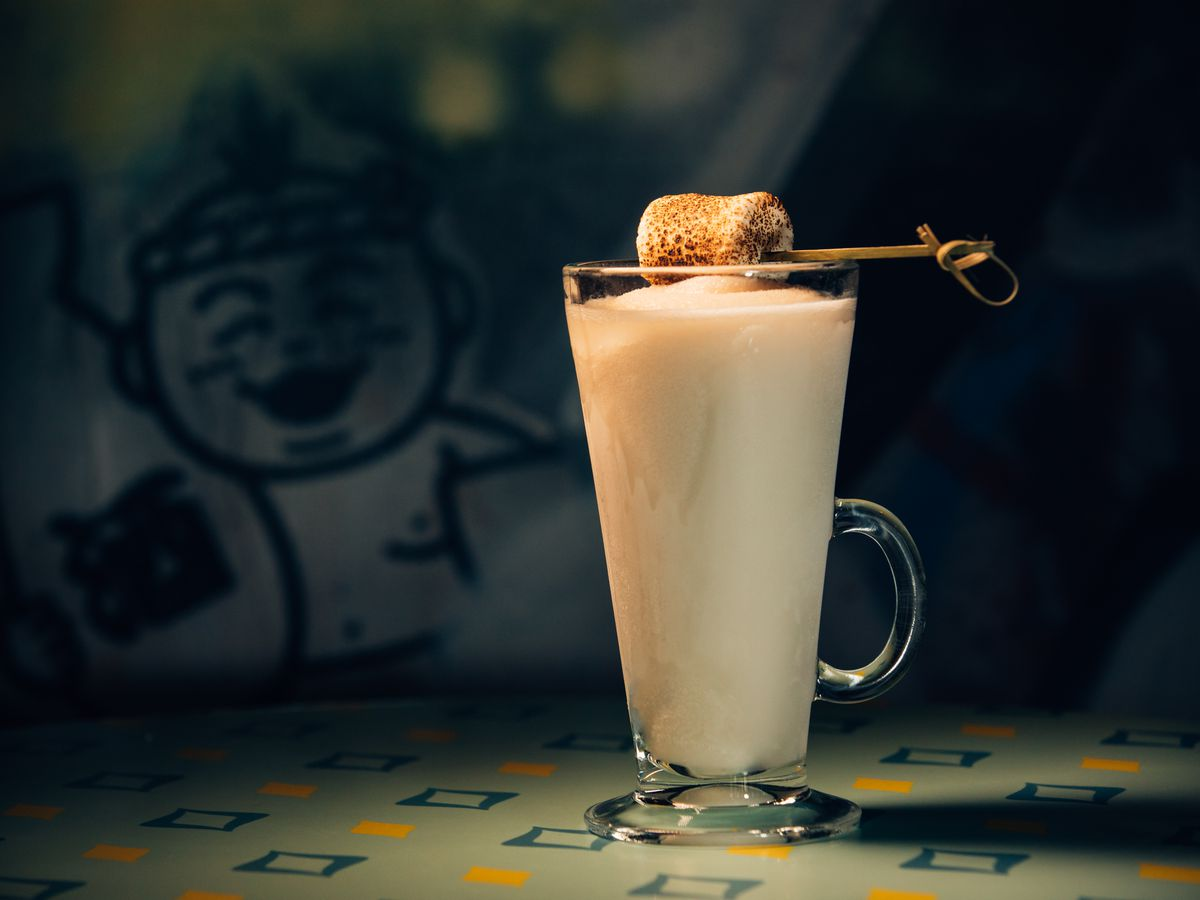 A pina colada is garnished with a toasted marshmallow