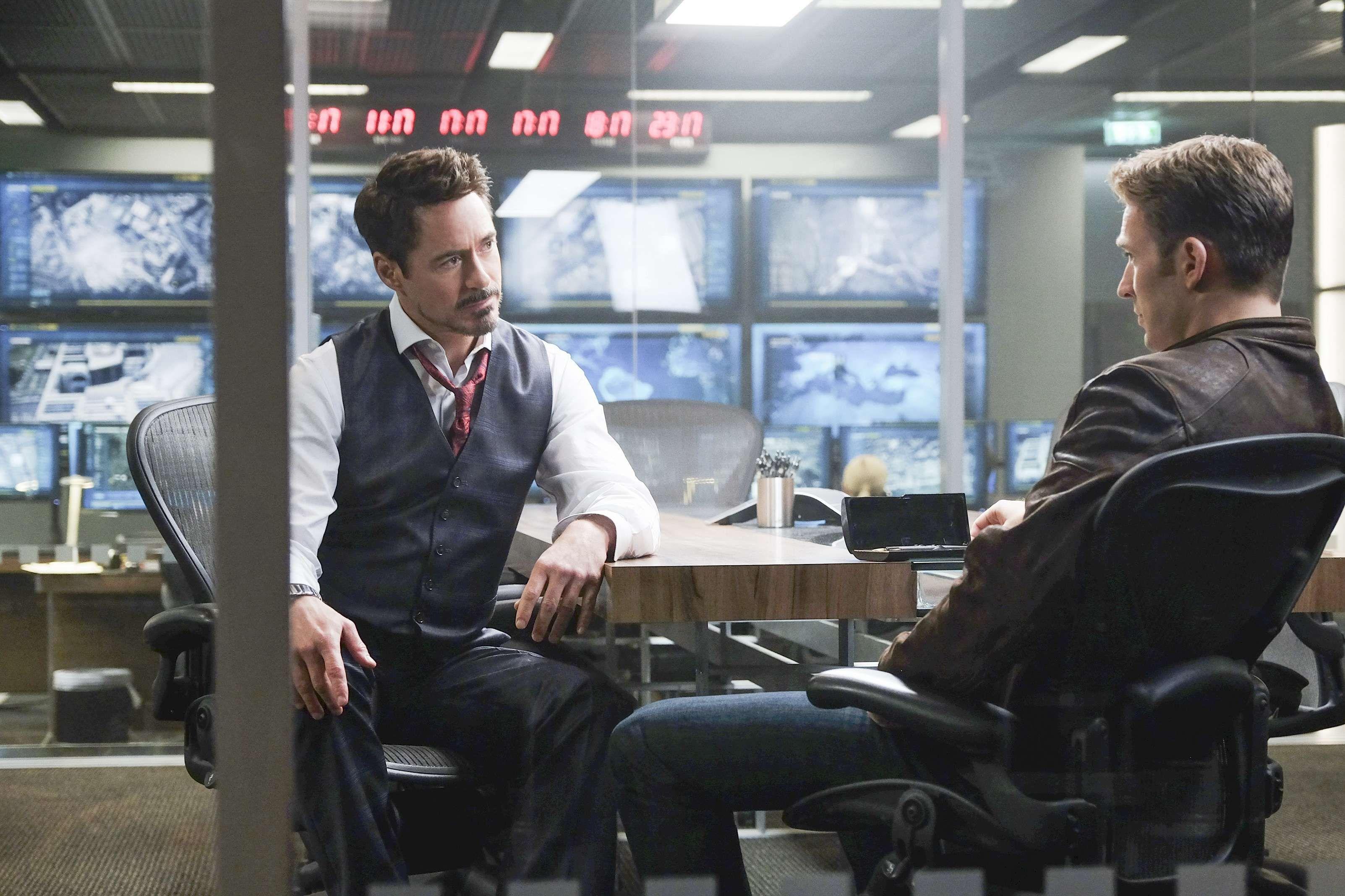 Robert Downey Jr. and Chris Evans as Tony Stark/Iron Man and Steve Rogers/Captain America in Captain America: Civil War (2016).