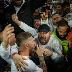 Ramos grabs the mic from the fans