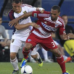 Real Salt Lake Luis Gil, left, and FC Dallas Scott Seally (31) vie for control of the ball during the first half of an MLS soccer game on Wednesday, April 25, 2012, in Frisco, Texas.