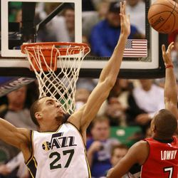 Utah Jazz center Rudy Gobert blocks a shot against Toronto Raptors guard Kyle Lowry during the game at the Energy Solutions Arena Wednesday, Dec. 3, 2014, in Salt Lake City.