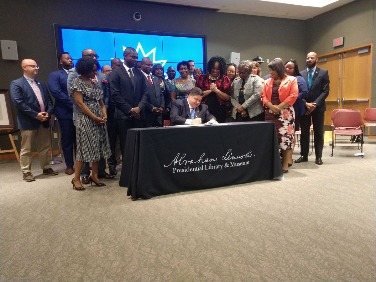 Gov. J.B. Pritzker signs a bill making Juneteenth a state holiday Wednesday, June 16, 2021.
