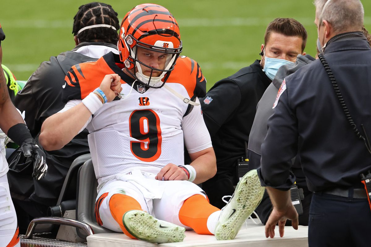 Cincinnati Bengals quarterback Joe Burrow (9) is carted off the field after injuring his left leg against the Washington Football Team at FedExField.